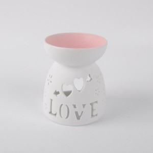 Engraved beautiful patterns porcelain aroma oil burner with tealight candle for wholesale